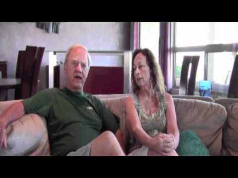 Man and woman sitting and talking -- Tucson HVAC