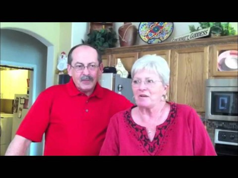Man and woman talking in kitchen -- Tucson HVAC